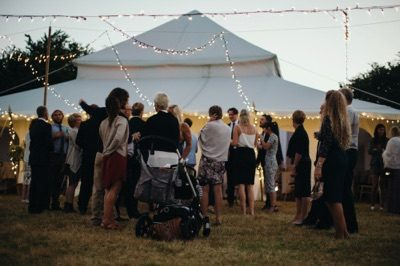 Guests outside wedding marquee